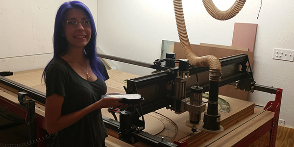 Sarah working on the CNC router
